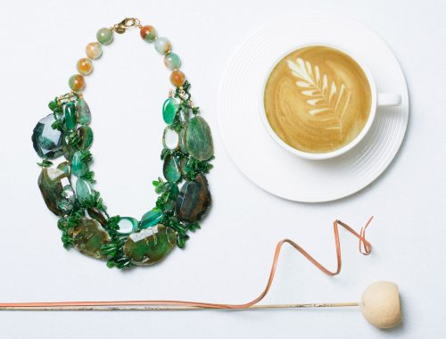 Green Agate necklace flat lay image with cappucino Product Photographers Commercial Photographers Midrand Johannesburg South Africa