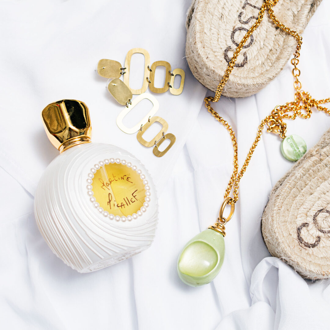 Ladies fragrance posed with sandals and jewellery flat lay Product Photographers Commercial Photographers Midrand Johannesburg South Africa