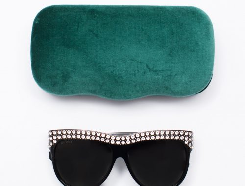 Gucci sunglasses with case on white background flat lay Product Photographers Commercial Photographers Midrand Johannesburg South Africa
