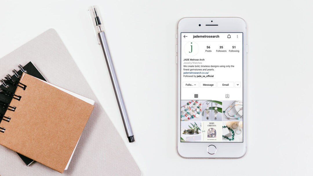 Social media on iPhone with notepad and pen Alter Image Digital Media Social media managers management Midrand Johannesburg South Africa