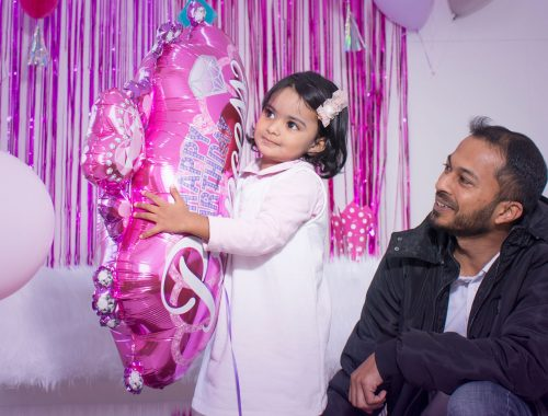 Father and daughter at birthday party event photography