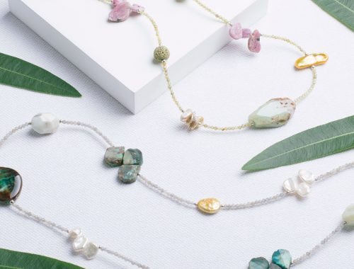 Pearl and gem necklaces with leaves on white product stage Professional Photographer Commercial Photographers Midrand Johannesburg South Africa