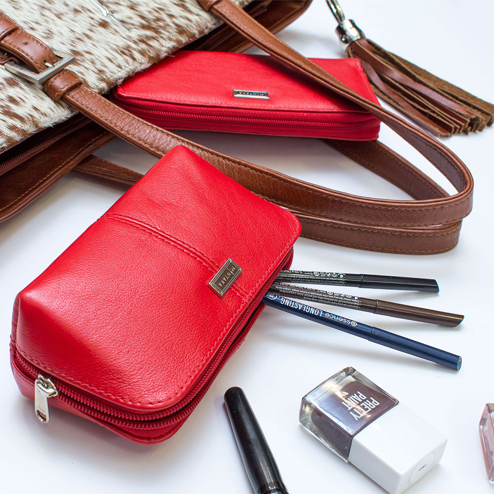 Mintaka red leather pouch with cosmetics and handbag flat lay photography Product Photographers Commercial Photographers Midrand Johannesburg South Africa